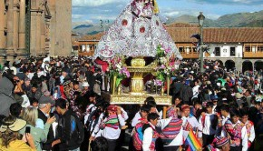 A statue of Santa Ana being carried from the Cathedral of Cuzco, Peru, for the Corpus Christi procession
