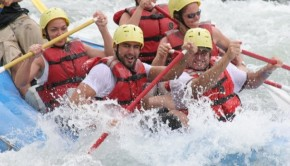 The group hitting the rapids on an exciting whitewater rafting tour.