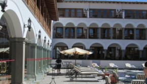 Guests at Palacio Nazarenas can soak up the Cusco sun on chaise lounges by the swimming pool.