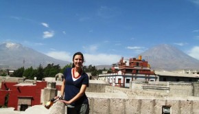 Kate on the roof of the San Francisco Monastery with the Chachani Mountain and Misti Volcano in the background.