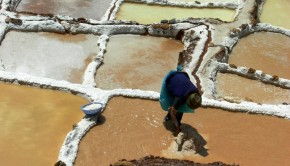 mining salt at Maras Salt Mines in the Sacred Valley