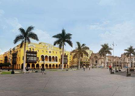 Yellow-painted Municipal Palace with classic Lima wood balconies