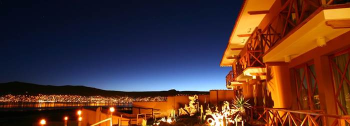 The view of the lake at night from the personal terraces of Casa Andina in Puno, Peru