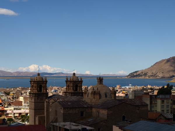 The view of Lake Titicaca from the shores of Puno, Peru