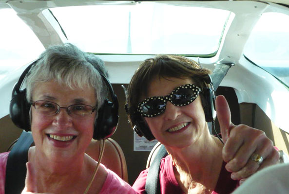 Bev and Carol in a plane over the Nazca lines