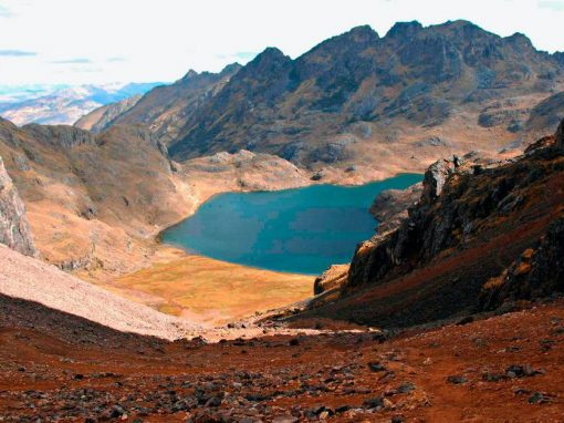 A blue lake surrounded by Andean mountains along the Lares Trek in Peru.