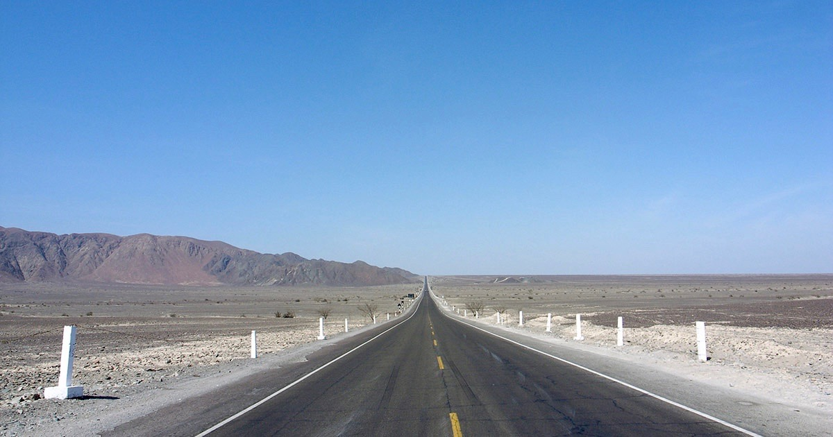 The open Pan American Highway going through the arid coast of Peru.