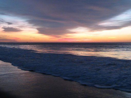 The sun setting over the beach in Mancora, a beautiful resort town in northern Peru.