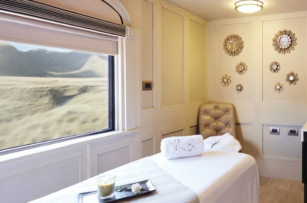 Massage car with Andean Scenery out the Window on Belmond Andean Explorer train in Peru.