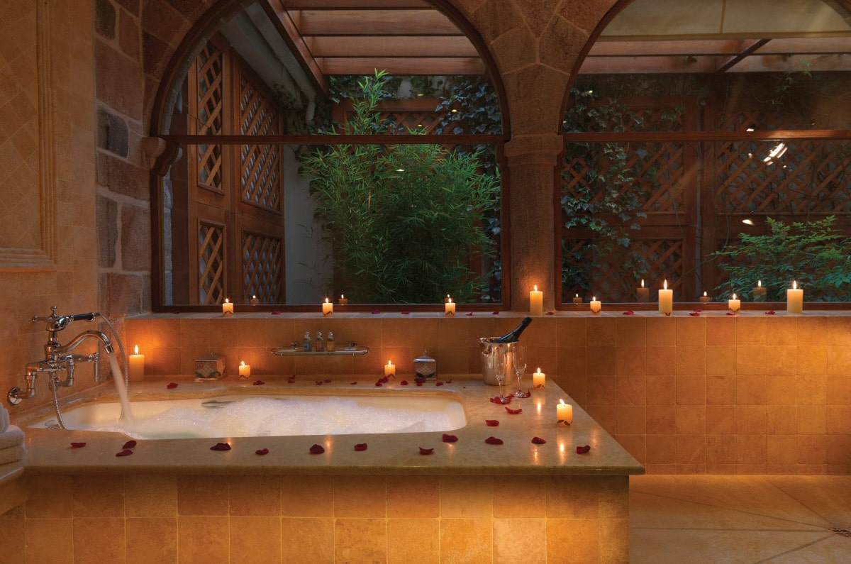 Andean bath with rose petals and candles at Hotel Monasterio in Cusco.