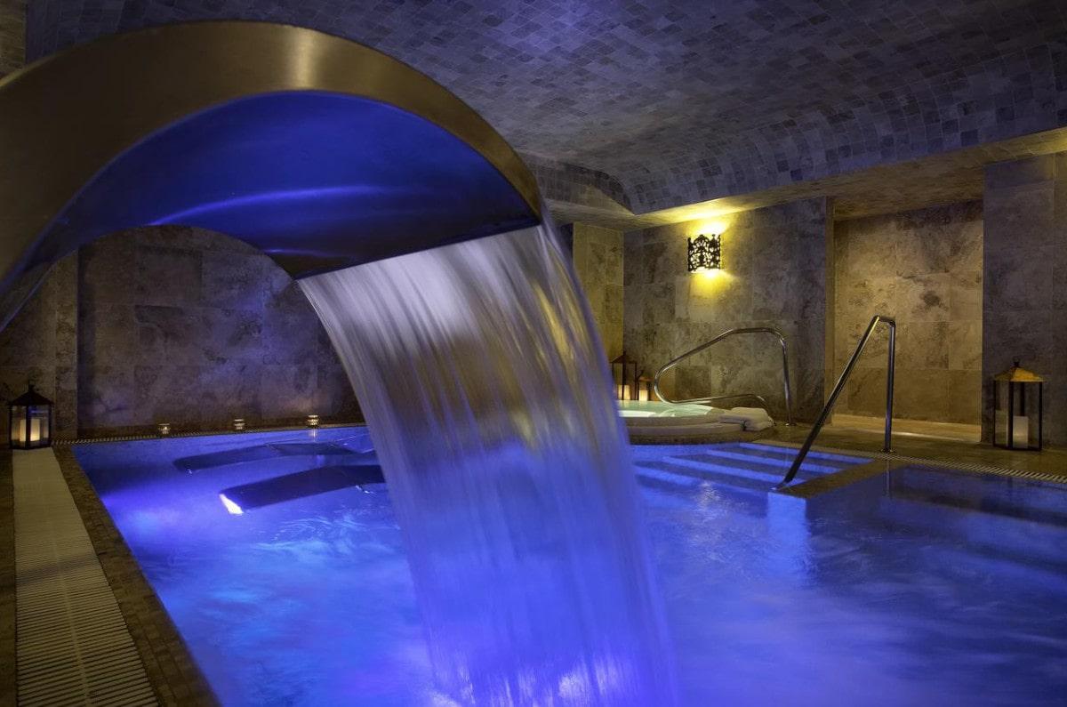 A indoor waterfall at the hydrothermal pools at Palacio del Inka spa resort in Peru.