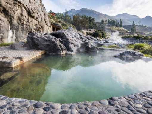 Hot springs nestled in a canyon landscape at Colca Lodge, one of the best spa resorts in Peru.