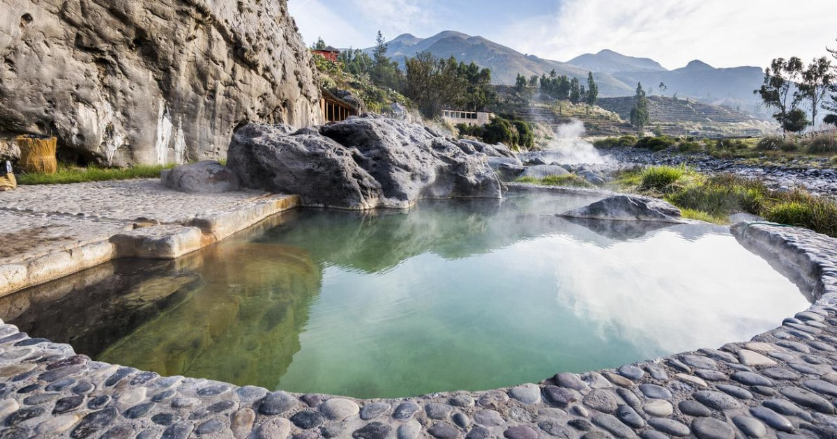 Hot springs nestled in the canyon landscape at Colca Lodge's Eco Thermal Spa, one of the best spa resorts in Peru.