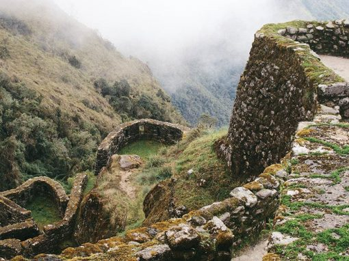 Inca ruins built from stone in the cloud forest along the Inca Trail to Machu Picchu.