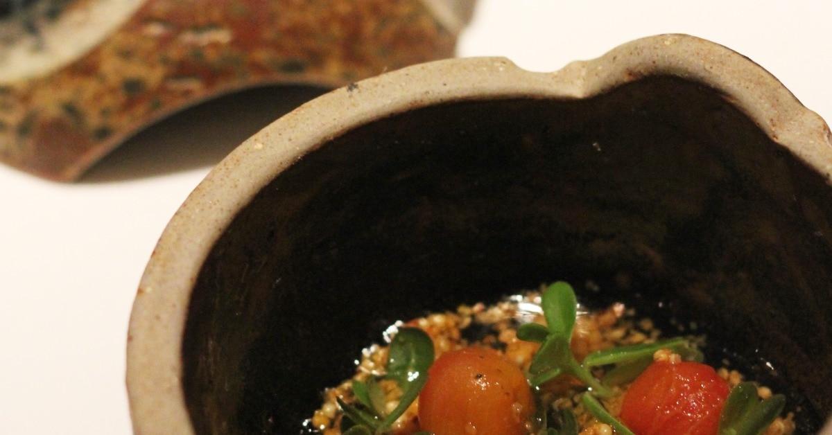 Food served in a ceramic bowl at Astrid y Gaston restaurant in Lima.