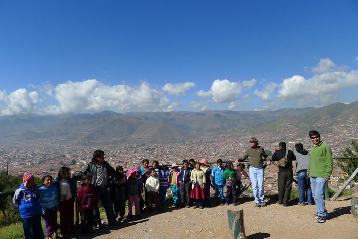 The children gathered at the viewpoint over Cusco from Sacsayhuaman