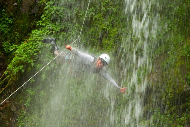 Thrill seeker zipping over El Manto de la Novia in Baños, the adventure capital of Ecuador.