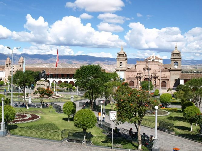 Cusco's Plaza de Armas during the day with blue skies during Semana Santa