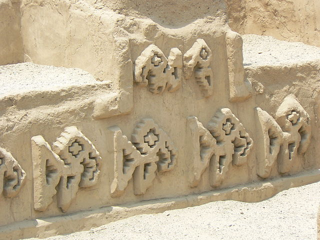 Adobe fish figures engraved in a wall of Chan Chan, an archaeological site in Trujillo, Peru.