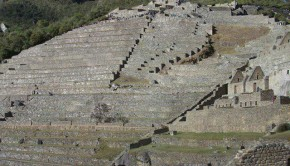 The Guardian's Hut is visible in the upper middle. Dozens of terraces and thousands of stone steps connect the different sectors of Machu Picchu.