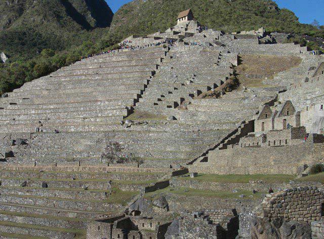 The Guardian's Hut is visible at the top middle of the picture and is the place to go for panoramic pictures of Machu Picchu. Dozens of terraces and thousands of stone steps connect the different sectors of Machu Picchu.