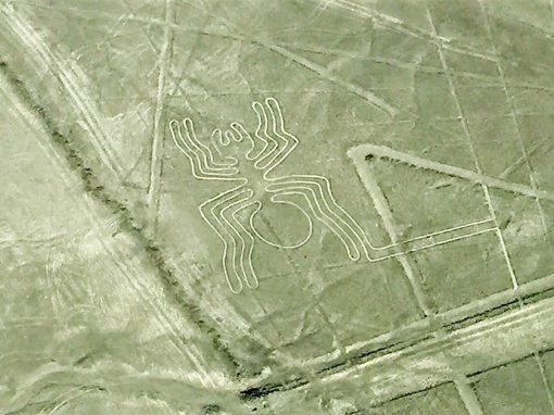 Flying over the desert of Peru and looking down on the Spider Nazca Line.