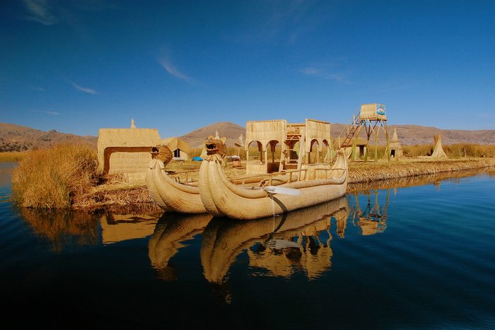The Uros, floating artificial islands made of woven totora reeds.