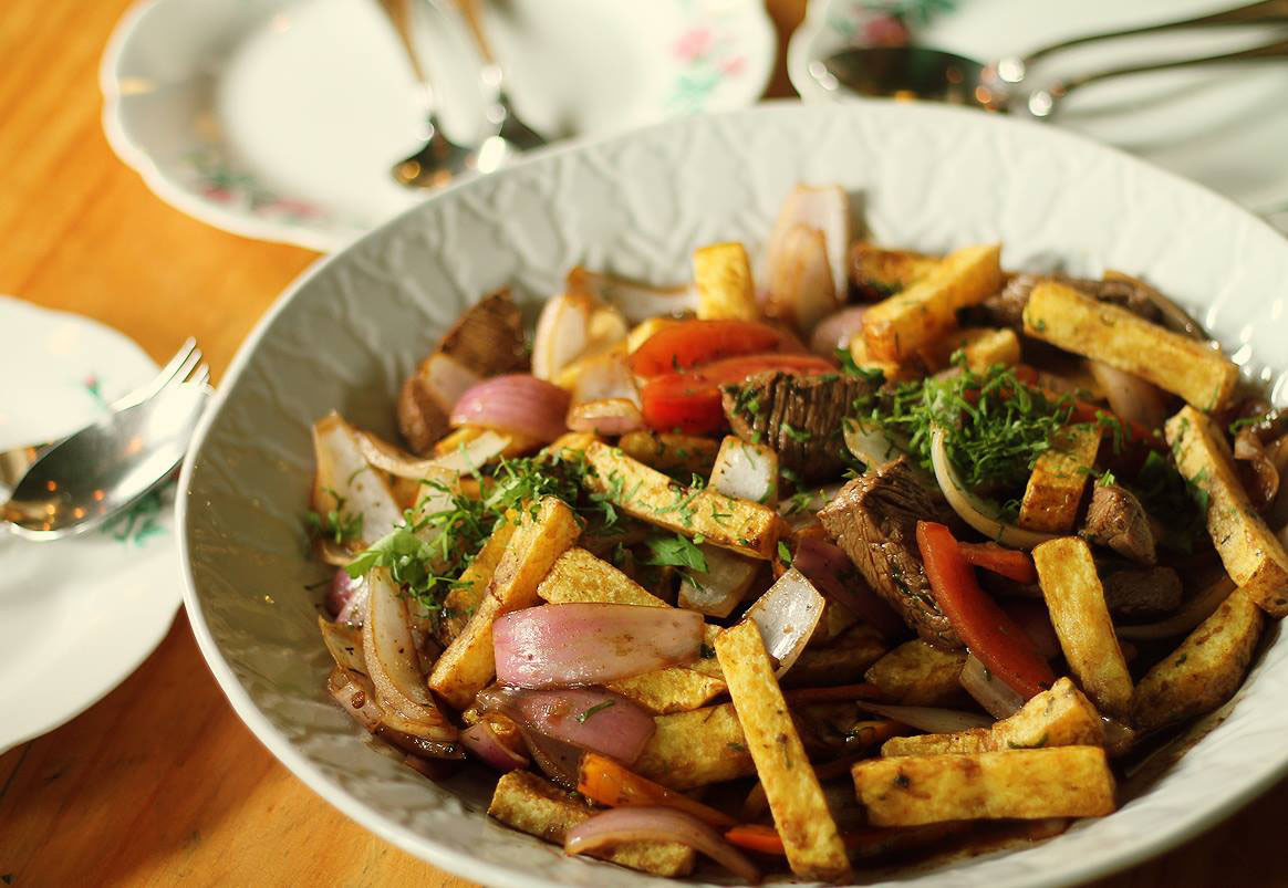 A plate with beef and vegetable stir fry at Isolina, one of the best restaurants in Lima.