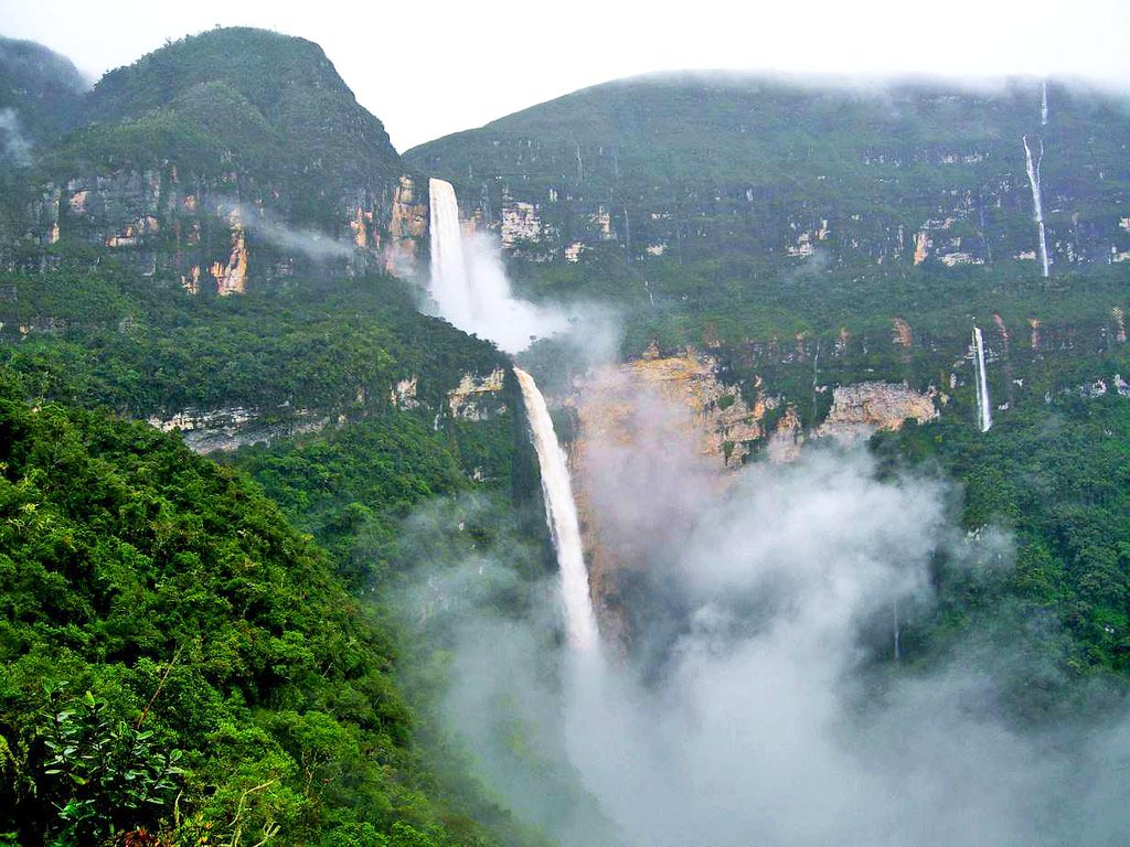 A waterfall with lots of fog at the bottom in the Amazon Rainforest.