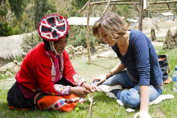 A volunteer learning how to hand spin yarn. Photo by Awamaki