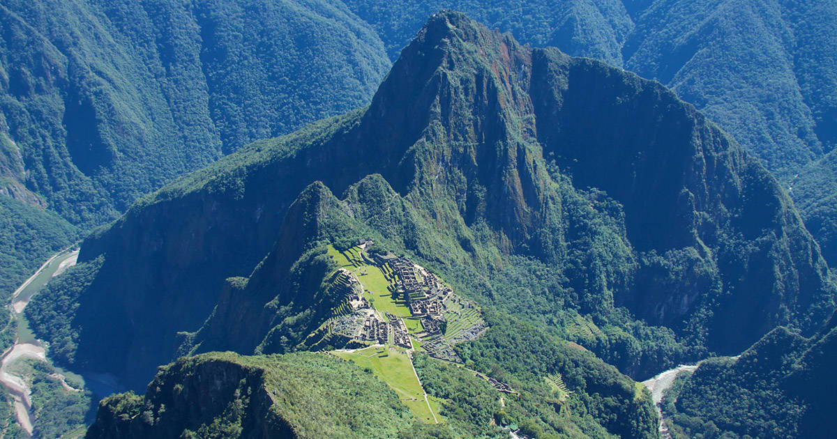 A view of the Machu Picchu ruins and surrounding mountains from the top of Machu Picchu Mountain.