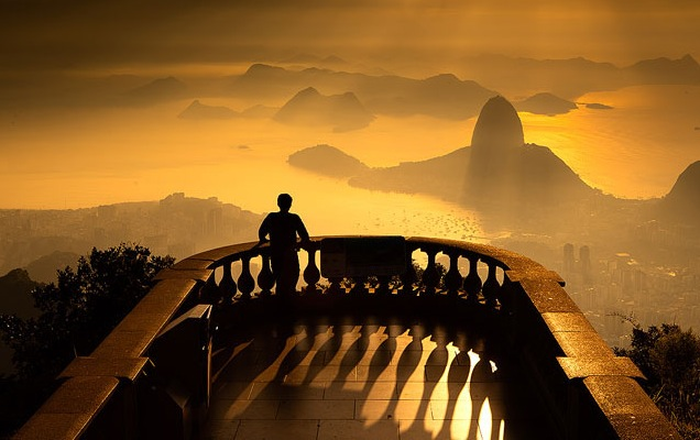 Sunrise over Sugarloaf Mountain from Christ the Redeemer in Rio de Janeiro. Photo by Flavio Veloso