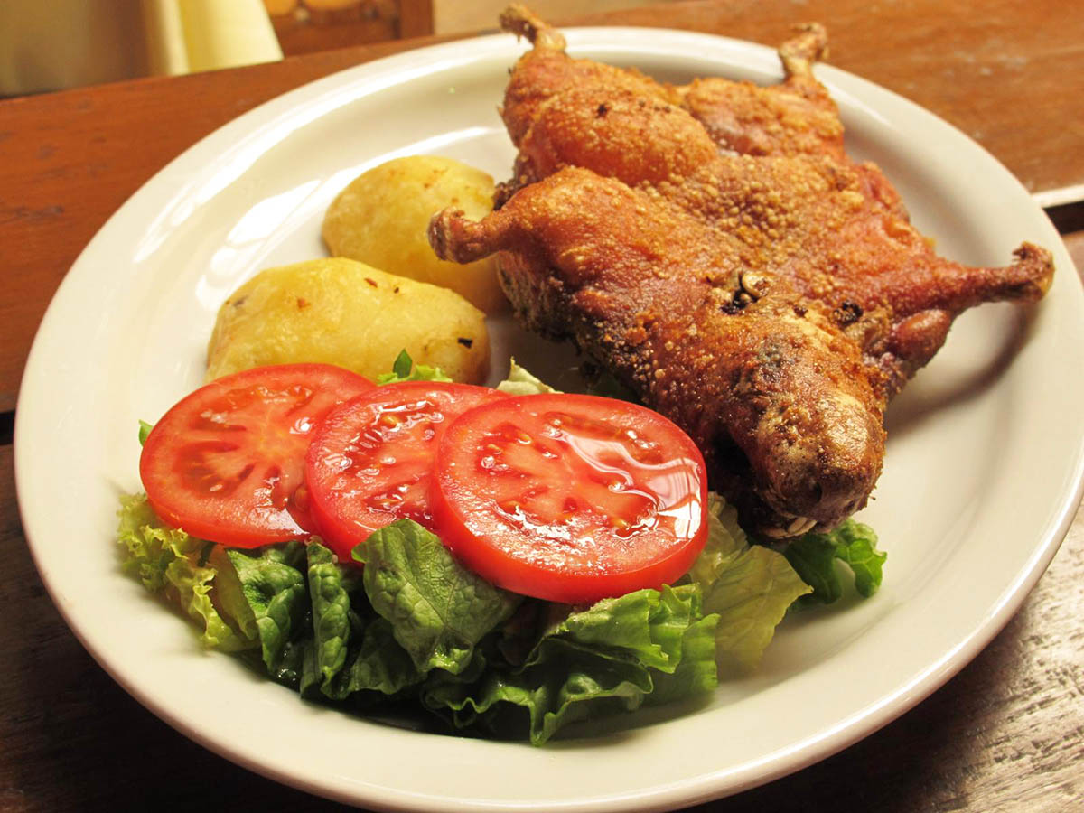 A whole fried guinea pig served with potatoes and salad is a Peruvian delicacy.