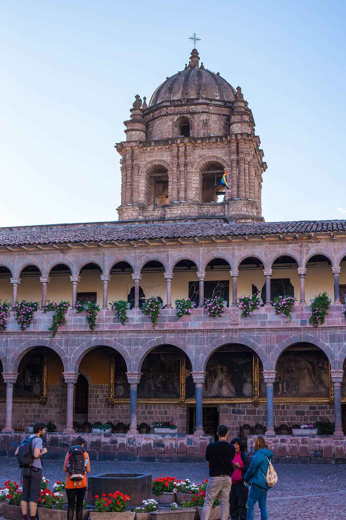 Two stories of arcaded paths surround the courtyard of the stone Santo Domingo church.