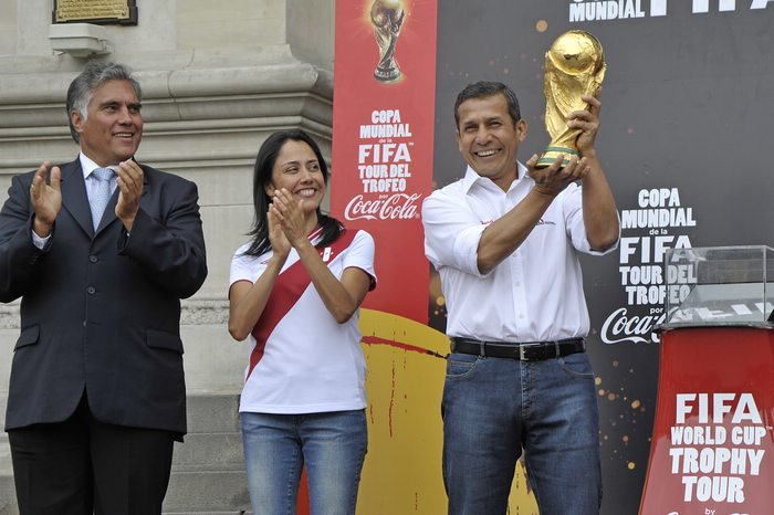 Ollanta Humala, president of Peru, holding the FIFA World Cup Trophy.