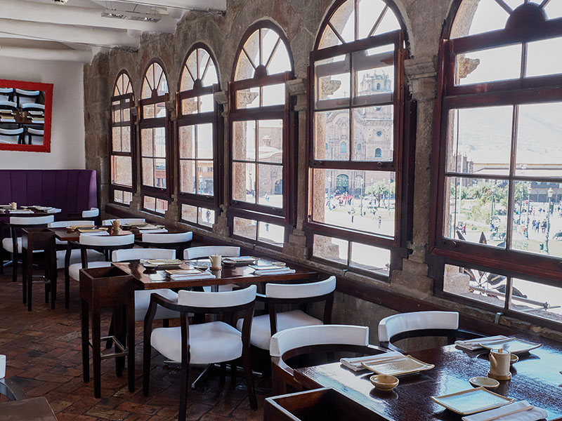 Interior of Limo restaurant, with view out the window of the Plaza de Armas in Cusco Peru