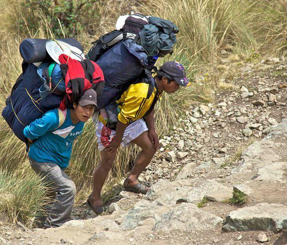 Trekking Porters on the Inca Trail to Machu Picchu in Peru
