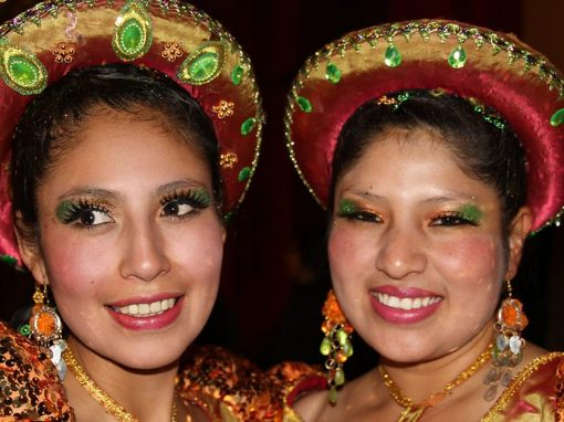 A pair of women wearing shiny gold costumes at the Virgen de la Candelaria Festival in Puno.