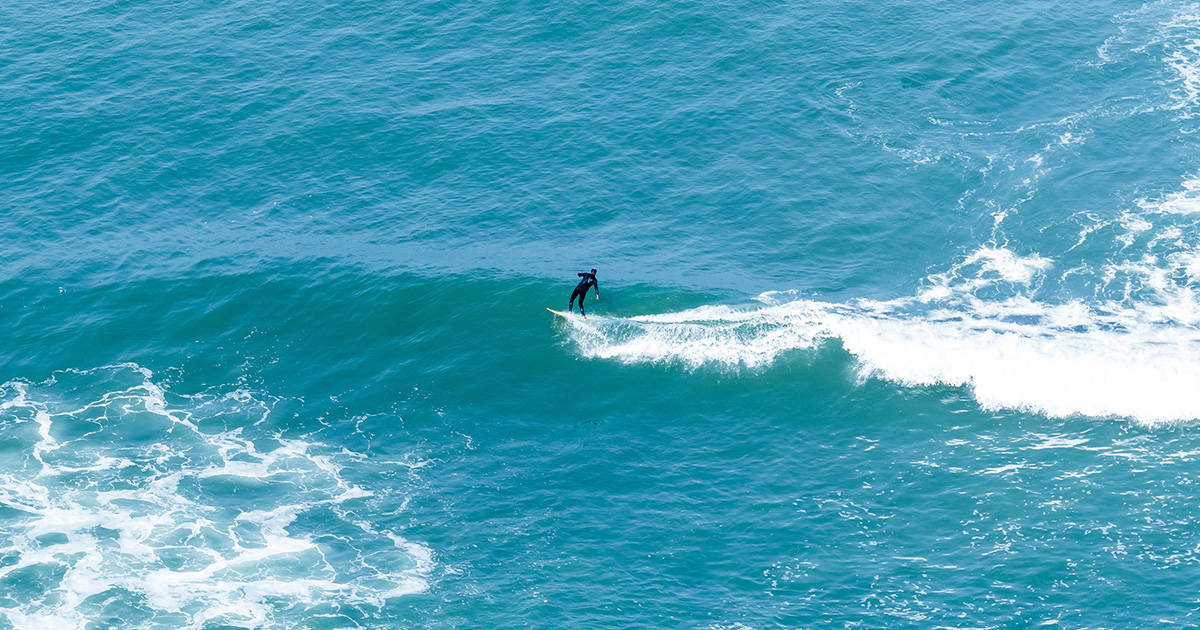 A surfer catching some waves in the water off the coast of Lima, the capital of Peru.