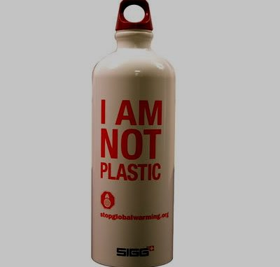 """A reusable bottle with a white background and red writing: """"I am not plastic"""""""