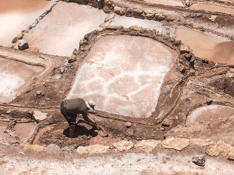 Salt being mined at the Maras Salt Mines near Cusco, Peru.