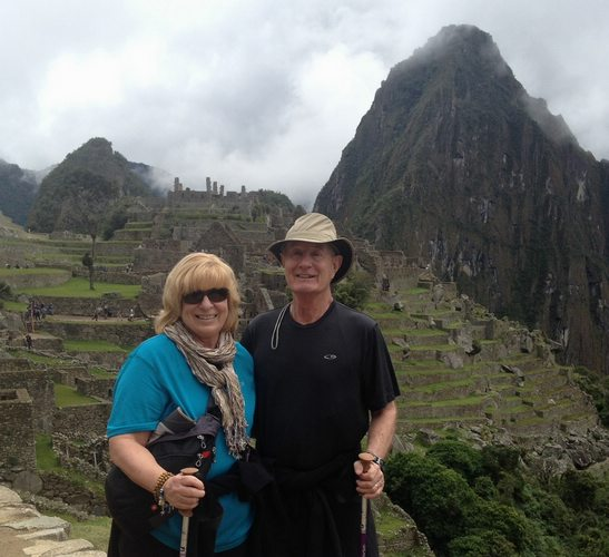 two Peru For Less travelers posing for a photo infront of Machu Picchu in Peru