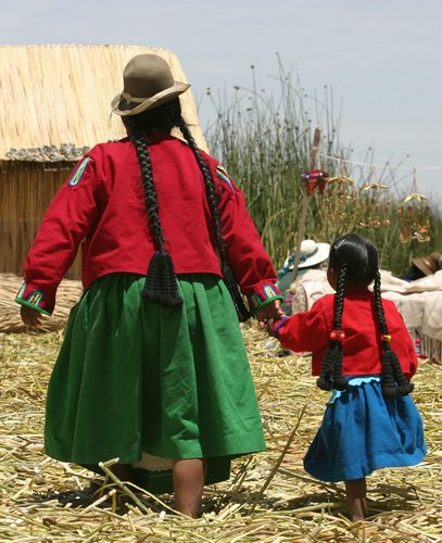 A mother and child on Uros, the floating islands in Peru