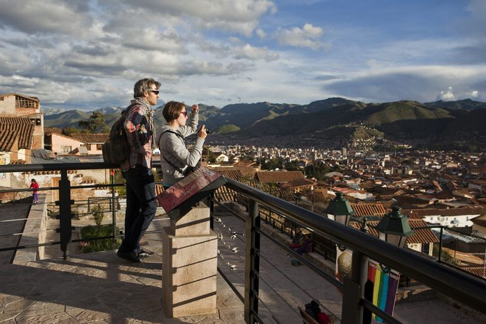 enjoying a beautiful view over Cusco City in Peru