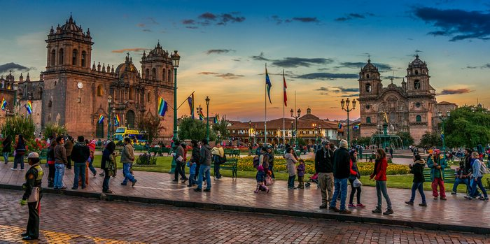 Life passes by in Cusco's central plaza