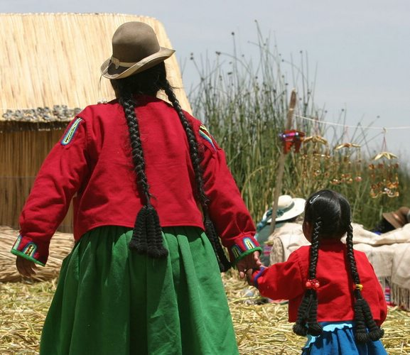 An indigenous mother with her daughter on one of the Uros Islands of Lake Titicaca.