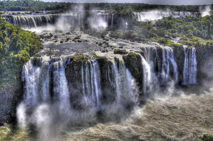 Tiers of massive waterfalls known as Iguazu Falls on the border of Argentina and Brazil.