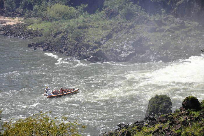A riverboat at the base of Iguazu Falls