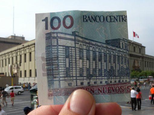 The Biblioteca Nacional in Peru and a note of 100 soles, the Peruvian national currency.