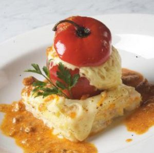 A close up of a cheesy rocoto relleno, a classic Arequipa food
